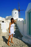 Happy young woman in a travel. Santorini Royalty Free Stock Photography