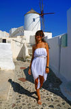 Happy young woman in a travel. Santorini Stock Photos