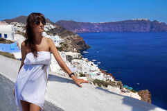 Happy young woman in a travel Santorini Royalty Free Stock Images