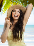 Happy young woman on tropical beach Stock Images