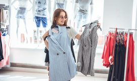 Free Happy Young Woman Trying On Various Brand Jackets In The Shopping Mall Royalty Free Stock Photo - 138452245