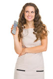 Happy young woman with tv remote control Royalty Free Stock Photos