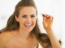 Happy young woman with tweezers Royalty Free Stock Photography