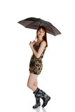 Happy young woman with a umbrella Stock Photo