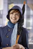 Happy young woman with umbrella Stock Photos