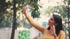 Happy young woman user holding smart phone