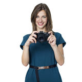 Happy young woman using a camera to take photo Royalty Free Stock Image