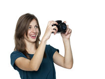 Happy young woman using a camera to take photo Royalty Free Stock Photos