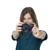 Happy young woman using a camera to take photo Stock Photos