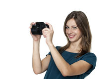 Happy young woman using a camera to take photo Royalty Free Stock Photography