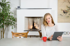 Happy Young Woman Using Digital Tablet At Home royalty free stock photo