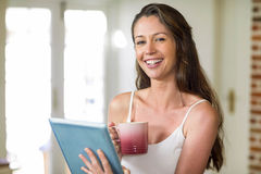 Happy young woman using digital tablet Royalty Free Stock Photography