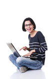 Happy young woman using her laptop Royalty Free Stock Images