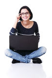 Happy young woman using her laptop Stock Photography