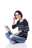 Happy young woman using her laptop Royalty Free Stock Photography