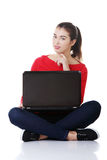 Happy young woman using her laptop Royalty Free Stock Photos