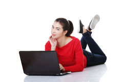 Happy young woman using her laptop. Royalty Free Stock Images
