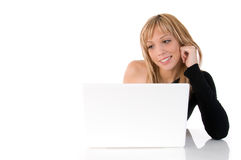 Happy young woman using laptop. Closeup portrait of a happy young woman using laptop. On white background Stock Images
