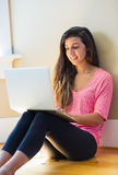 Happy young woman using a laptop computer Royalty Free Stock Photo