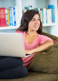 Happy young woman using a laptop computer Stock Photo