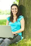 Happy young woman using laptop outdoors Royalty Free Stock Photography
