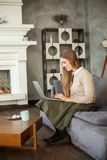 Happy Young Woman Using Laptop and Surfing the Web Stock Photo