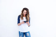 Happy young woman using smart phone. Portrait of happy young woman using smart phone Royalty Free Stock Photo