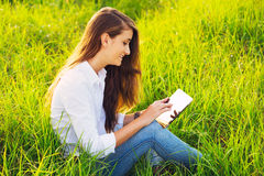 Happy Young Woman Using Tablet Royalty Free Stock Photography