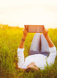 Happy Young Woman Using Tablet Royalty Free Stock Image