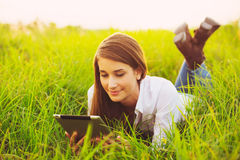 Happy Young Woman Using Tablet Royalty Free Stock Photo