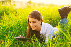 Happy Young Woman Using Tablet Stock Photos
