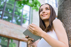 Happy young woman using tablet outside Royalty Free Stock Photo