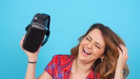 Happy young woman using a virtual reality headset stock video footage