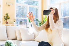 Young woman using virtual reality headset Stock Photography
