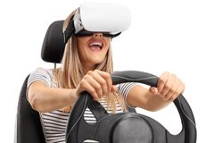 Happy young woman using a VR headset and driving Stock Photo