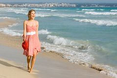 Happy young woman on vacation royalty free stock photography