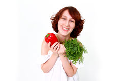 Happy young woman with vegetables Royalty Free Stock Images