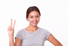 Happy young woman with victory fingers Stock Images