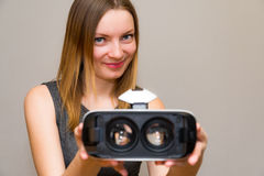 Happy young woman with a virtual reality headset Royalty Free Stock Photo
