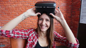 Happy young woman with virtual reality headset