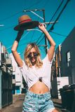 Happy young woman walking in the street. Royalty Free Stock Photo