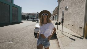 Happy young woman walking in the street. stock footage