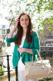 Happy young woman walking with bag outdoors Royalty Free Stock Photography