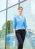 Happy young woman walking outdoors Royalty Free Stock Images
