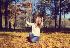 Happy young woman walking in park. On sunny autumn day Stock Images