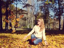 Happy young woman walking in park. On sunny autumn day Stock Image