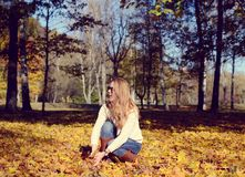 Happy young woman walking in park. On sunny autumn day Stock Photo