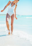 Happy young woman walking at seaside Royalty Free Stock Photo