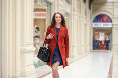Happy young woman walking in the shop Stock Images