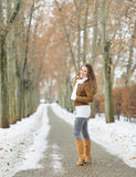 Happy young woman walking in winter park Stock Photo